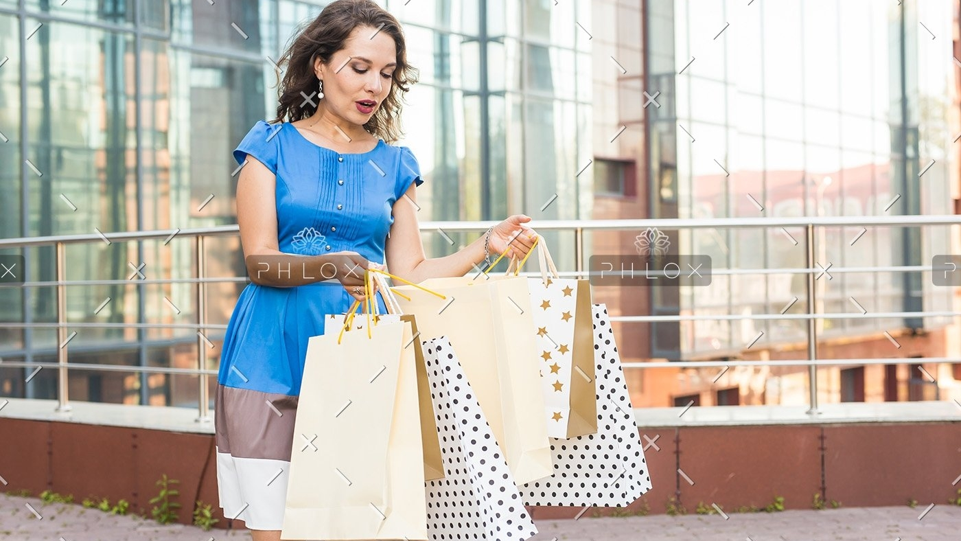 shopper-shopaholic-shopping-woman-holding-many-PCWUSW9