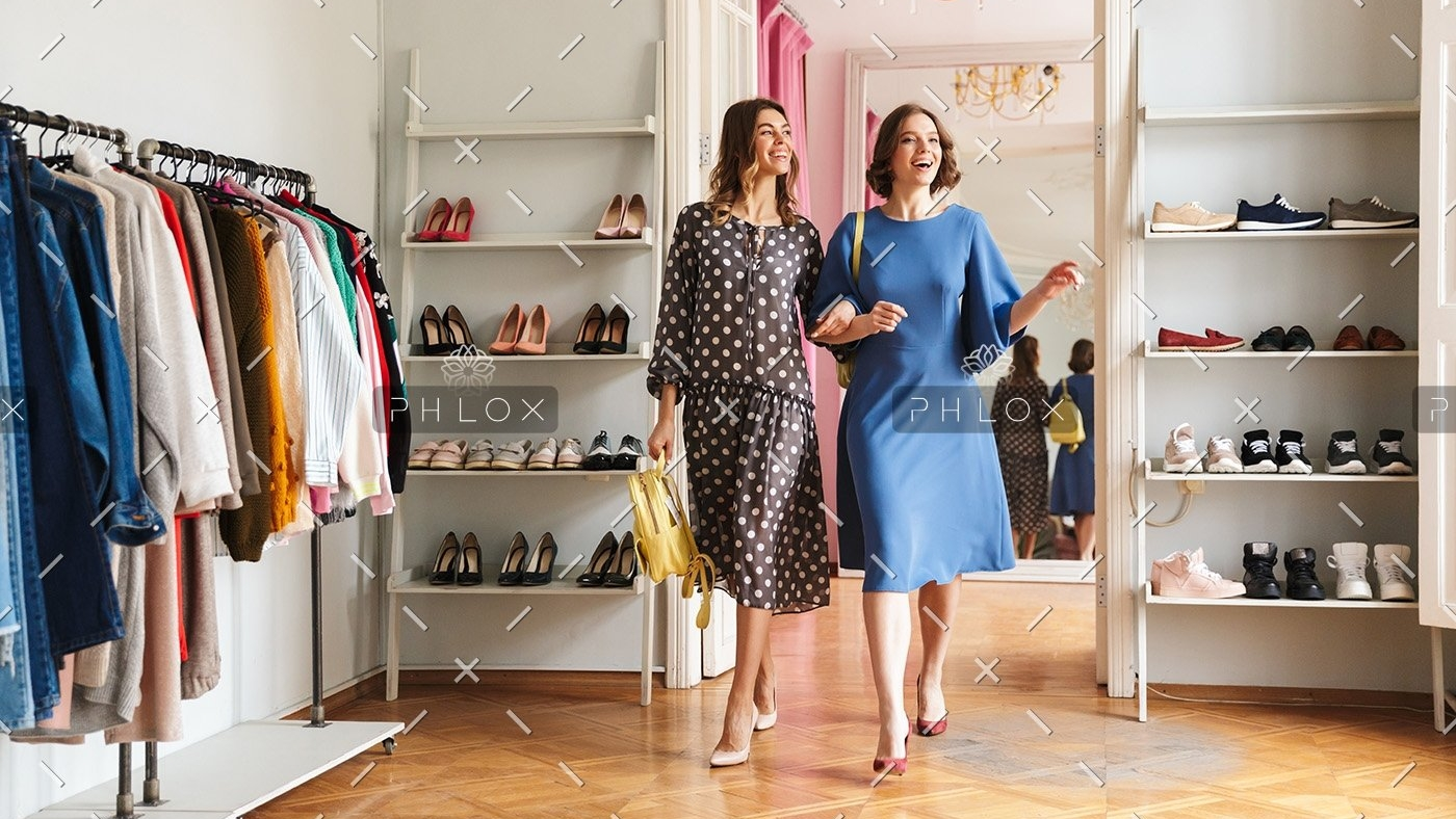 two-pretty-young-women-shopaholics-P2R9ZTE